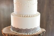 Wedding Cake Toppers / The cake is a focal point of many weddings - how will you top it? From figurines to initials to comical toppers, get ideas!