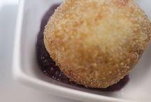 Polpetta di stoccafisso / Lo stoccafisso secco viene lungamente lessato, manualmente eliminiamo tutte le lische, è un lavoro di pazienza, lo tritiamo e lo impastiamo con le patate lesse, lo insaporiamo con un soffritto di pomodorini del Vesuvio , capperi ed olive, sale quanto basta e gli diamo la classica forma a sfera, arrotolandolo nella semola rimacinata. Da parte prepariamo una crema di cipolle di Tropea, stracotte nell' Aglianico e poi frullate.   Info al 081 8991067 / 333 2963740