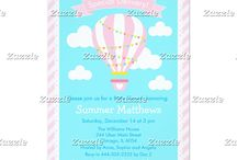 Special Delivery Hot Air Balloon Baby Shower Pink / This collection features a pink hot air balloon with bunting. The background consists of clouds on sky blue, a scallop edged frame and pink stripes.