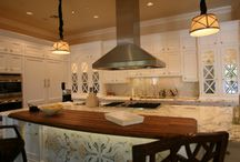 Picasso Kitchens / Picasso Tile & Stonework specializes in custom tile and stone creations in kitchens such as kitchen tile or slab backsplash creations, slab countertop edges, detailed tile mosaics for flooring, wall mosaic tile designs, and custom cut patterns of slab or tile! Have you already chosen your kitchen cabinets and need to design a slab countertop to fit with your kitchen cabinets? Picasso Tile & Stonework can customize the size of your slab to your kitchen cabinets!