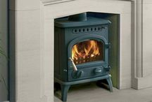 Firewarm Multi Fuel & Wood Burning Stoves / Firewarm offer a small range of simply styled cast stoves in three sizes. These include riddling grates, airwash technology and many other features typically found on more expensive stoves.