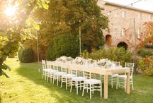 Romantic Tuscan Abbey / An Irish groom and a Chinese girl fly to Tuscany to get married in the most romantic open air church all over Italy:The majestic S Galgano Abbey.The September light helps to have a magical wedding The soft palette of pink blush and creamy colors create a romantic mood;a linear string of bulbs is the perfect light design for such an intimate dinner A delicious olive oil bottle will be the thanksgiving for guests A beautiful naked cake will be cut and a first dance will close this intimate wedding