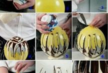 chocolade cup maken met ballon / ballon opblazen,chocolade smelten,ballon in de warme cghocolade dopen en vervolgens laten afkoelen. Ballon voorzichtig verwijderen