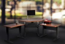 Ergonomic Office Solutions / Innovative workspace products available include adjustable height desks, keyboard tray systems, monitor supports, footrests, wrist supports, laptop drawers.