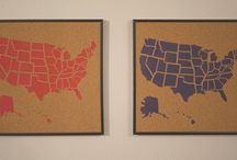 USA Cork Board Maps COMING SOON! / COMING SOON! A Travel Goal Getter & All Fifty Club original! Hand painted and assembled in the USA - mark your map & set your goals! Great for home or office. Framed, this map looks great on a wall (we even include a nail!). Without a frame it's light enough for a fridge (we even include magnets!). 50 Flag pins are included. Choose your color! Where are you going next? That's up to you!