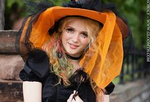 Gloomth Candy Witch / A Halloween inspired photoshoot featuring a rainbow hair model Poppy in a cute candy witch outfit. Great costume inspiration! Kawaii lolita fashion Halloween look. Orange and black, striped stockings and socks. Adorable goth style