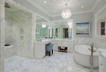 CASATOPIA | Bathrooms / Bathrooms by Casatopia, LLC featuring custom tile patterns, cabinetry, lighting & more!