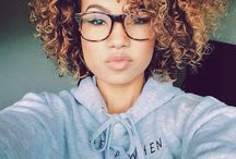 curly hair and glasses