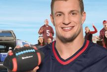 #GronkBall Rob Gronkowski - Gronk Ball Bluetooth Speaker Football / The Gronkball Speaker is built to be played with while it provides the soundtrack at tailgate session, cookouts, or backyard hangs. A Bluetooth speaker is wrapped inside the foam football-shaped design and amps up even a casual game of catch with your party playlist. Light-up laces and stripes can be set to match most team colors, and just plain look cool at nighttime gatherings.