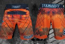 2015 Pro Board Shorts / Heavy Duty fight Gear Pro MMA Shorts have quickly become the favourite apparel for fighters all over the world. Our unique designs and digital printing process allows us to inject the inks directly into the fabric giving long lasting vibrant colours.