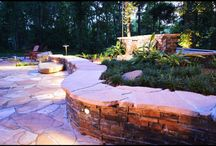 Waterfall Patio Design / This Jacksonville, FL backyard was already beautiful because of the surrounding woods but 5 Star Outdoor Design designed and built these homeowners a great area to be able to enjoy the woods even more. The stacked stone waterfall is built up just high enough to help hide the spa and give people in the spa a bit of privacy. 5 Star Outdoor Design also designed an outdoor kitchen with a stacked stone wall that helps block the view of the neighbors and truly makes this backyard feel secluded.