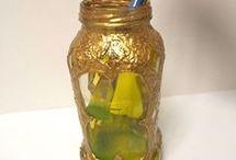 porta candela fatta con barattoli di vetro