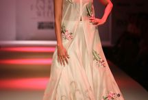 Rajputana by Samant Chauhan. WIFW. / The collection was dominated by floral accent embroideries. Capes and sheer silhouettes stood out on the runway, but the bouquet outfit grabbed most attention..