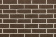 Select Series Clay Brick | Brampton Brick / Available as a special order in Metric Modular, Modular, Premier Plus, Metric Jumbo, Closure and Utility sizes, Select Series provides a cost-effective option for your commercial building project. With it's straight edges and velour texture, Select Series balances a traditional design with modern appeal. These clay bricks come in six colours, including Amber, Kodiak, Morrocan Red, Silver, Sundown and Valencia.