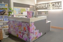 Visual Merchandising, Gift Card Promotion / This promotion was custom painted watercolour floral backgrounds that were utilised throughout the Customer Service area for a retail client. Playing on the fun and feminine feel of the floral design enabled our Visual Merchandising team to wrap around the desk and accentuate the design by cutting along the edge of the artwork. Gold Mirror Vinyl wording complimented the design which really lifted the feminine feel of this promotion. Youtube: https://www.youtube.com/watch?v=QfnppKmSROc