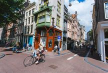 Amsterdam from #Jet2CityBreaks / Made up of shimmering canals interlinked with white drawbridges, you'll find beauty in the townhouses and open green spaces of Amsterdam.