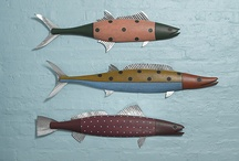 "Paul Sumner / Hand-carved by Paul Sumner, each fish is distinct with personality and incorporates Paul's sense of fun and whimsey. Playing with color, texture and pattern, he creates unique pieces that look great on the wall alone or displayed in ""schools."""