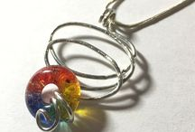 *Handmade Gems & Jewels / Who doesn't like a little sparkle? Jewelry for the creative in spirit and for those of you who  love to DIY - handmade glass lifesaver beads, pillow pendants, donut beads will spark your imagination.