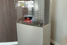 Pedestal Bases / We at DNS industries were contracted by Red Shift innovations to create mobile enclosures to house LEGO models for architectural use. 12 pedestal bases were created from brushed aluminum alupanel, white sinatra top with recessed castors, while the enclosure on the top was made from clear acrylic paint. Here are the results.
