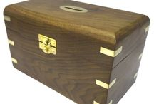 Timber-Treasures Rosewood money box large / Our money boxes are perfect for storing your loose change or a child's pocket money.  Each box is crafted from Indian rosewood and decorated with inlaid brass on the corners and on the coin slot in the top of the box. Each box also has brass hinges and locking clasp as well as the interior being lined in red felt. External dimensions - 18.5 x 10 x 11 cms* Internal dimensions - 17 x 8.5 x 9 cms* * handmade disclaimer