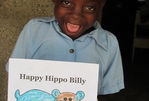 Coloring = Happy / Chimfunshi school children with their Happy Hippos!