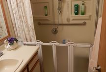 Shower with Caregiver Doors / Barrier-free shower systems with half-height caregiver doors for easy caregiver access without getting water on the floor.