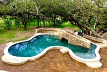 Grotto pool with bridge