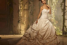 Wedding Gowns in General / a little of this, a little of that.  mostly white.  mostly classic, some contemporary, some goddess gowns....some tulle, some ruffles, some satin...and everything in between.   / by Kate Jeter