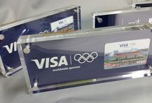 Unique and creative request... / A unique request was asked of Landmark signs to make desk gifts for Olympic Delegates for IMG. We love unique requests and this is how they turned out.