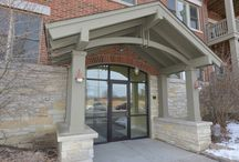 271 East Railroad Avenue Unit 304, Bartlett, Illinois 60103 / RARE opportunity & Commuters dream! Live in the life of luxury in the heart of dwntwn Bartlett just steps awy from metra. Top Floor w Opn flr plan for entertaining w_ huge island & custom cabinetry. Many upgrades throughout... Granite galore! Mstr bth w_ seated shower, dual sinks, separate soaker tub. 2 heated garage PARKING (handicapped accessible). Elevator. In unit wshr_dryer. Steps aways from shops, trains, park