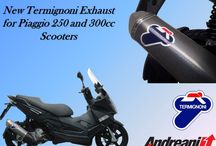 "Termignoni for Piaggio 250 and 300cc Scooters / New Termignoni Exhaust for Piaggio 250 and 300cc Scooters.After the big success of the exhaust developed for the Yamaha T-Max 530, Termignoni extends his range creating homologated silencers for the 250 and 300 cc scooters made by Piaggio Group. Characterized by the Relevance design they are realized in stainless steel with the ""Poppy"" carbon look sleeve. In the countries where needed is possible also to have the catalyzer."