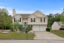 3603 Albury Lane, Austell, GA 30106-1473 / Listing Agent: GLENNDA L BAKER; (678) 755-3711; glennda@glennda.net; Lovely and upgraded to the max! Hardwood floors throughout, granite counter tops, stainless appliances. Light bright and open floor plan in close in location, convenient to shopping and dining at the East West Connector Corridor. Completely finished terrace level with rec room, full bath and bedroom.  Vaulted master suite with large picture window. 2 additional guest bedrooms and guest bath.