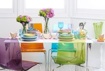 Clear and coloured acrylic chairs