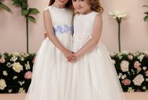 Flower Girl Dresses / We carry a magnificent collection of wedding flower girl dresses in satin, tulle, Dupioni silk and beautiful tulle overlays, rich embroidery, beading and much more!! We also offer flower girls dresses that are absolutely magnificent for outdoor weddings.