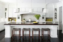 CLASSIC KITCHENS / What is classic? The answer is as varied as cooks are. Still, white or cream kitchen cabinets, simple architectural details and black accents offer a blank slate that homeowners can personalize with contemporary, traditional and eclectic touches as they see fit. Sheila Schmitz