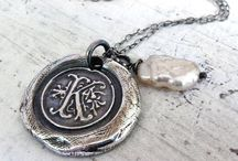 Wax seal jewelry made from Nostalgic Impressions Wax Seal Stamps