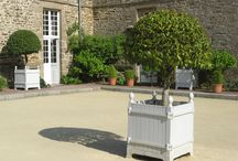Authentic Versailles Citrus Planters / The Versailles citrus planter was created to ensure the survival of delicate and exotic fruit trees at the palace. Originally they were intended for the gardens of King Louis XIV at the Palace of Versailles, but now they are ready for your home and garden.