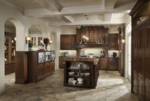 Elegant Traditions / Sophistication is defined by the interplay of luxury materials and appliances with the timeless details of this highly functional kitchen, which includes a pantry with open shelving and an extensive china cabinet.