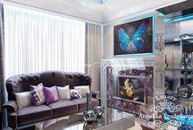Дизайн-проект квартиры в стиле Ар-Деко на улице Молодежная / Интерьер выполнен в стиле Ар-Деко для квартиры на улице Молодежная. В доме много предметов с зеркальной поверхностью и дополнительных светильников, поэтому все помещения прекрасно освещаются в любое время суток. За счёт белого, сиреневого и серого цвета декоративных элементов, чувствуется весеннее настроение и уют.