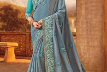 2677 LAGAN PARTY WEAR SILK SAREE / All the Fashionable women will surely like to step out in style wearing this grey color two tone silk fabrics saree. this gorgeous saree featuring a beautiful mix of designs. look gorgeous at an upcoming any Party wearing the saree. Its attractive color and designer heavy embroidered design, Flower patch design, beautiful floral design work over the attire & contrast hemline adds to the look.