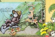 Monkeying Around Collection / The new Monkeying Around Collection by Heartfelt Creations is filled with amusing illustrations of ever so charming monkeys. Four entertaining cling stamp sets supply you with an assortment of fun filled, mix and match monkey images to create just the right amount of monkey mayhem for any of your paper crafting project needs, while various sized palm tree fronds, floral accents, bananas, coconuts along with lush palm tree die cuts add a dimensional tropical feeling to your projects with ease!