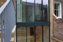 Project: Kensington Gate / A double height rear extension in one of the toughest conservation areas in the country to  Grade II* listed house. IQ Glass used minimally framed sliding glass doors on both floors with a frameless glass balustrade to the upper floor to create a Juliette balcony