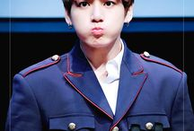 "A Kookie / Jeon Jeong-guk (전 정 국) Position: Main Vocalist, Lead Dancer, Sub Rapper, Center, Maknae  Birthday: 1 September 1997 Height: 178 cm (5'10"") Weight: 66 kg (154 Ibs) Blood Type: A Birthplace: Busan, South Korea"