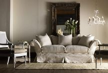 Cottage style / A 1980's style. Cottage-inspired look includes weathered white-painted furniture, painted motifs, floral prints in muted colors, white slipcovered sofas and vintage accessories. A sense of brightness and airiness is always evident in these interiors.