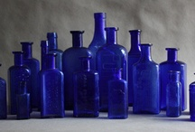 Vintage bottles, tin,signs and adverts