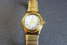 "Swatch Watches / Here will be listed a huge collection of Swatch Watches such as : -1995 Swiss Swatch Watch Irony Metal band, Gold Tone, 1995 Swatch Irony Medium 'ODALISQUE"" YLG102 -1991 Standard Swatch Watch Genji GB723 . Unique Chinese Model, beautifully preserved -GJ106 New Swatch 1991 Champ Fluorescent Green Authentic -1990 Vintage Swatch Watch Honor Ride GJ104 . -1990 GN106 Swatch Watch Hopscotch Gently NEW! -GB139 Swatch 1991 Engineer, Swatch Leonardos Engineer GB 139 Colletion from 1991 - and more!"