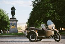 """Мотоцикл «Урал» - Motorcycle """"Ural"""" / Урал — единственный мотоцикл, спроектированный с коляской, что отличает его от других мотоциклов.  Первый мотоцикл был разработан 70 лет назад, и его потомки в наши дни являют собой прекрасное наследие, в чем вы можете убедиться сами.  Мотоцикл Урал — одно из тех редких технических чудес, которые пережили своих создателей. Он спроектирован для сложных погодных условий и, не смотря на импортную внутреннюю комплектацию, обладает поистине русским менталитетом!"""