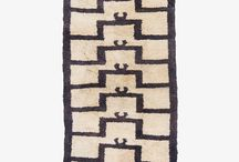 Tulu / Tulu rugs can be identified by their two prominent features: long and protruding piles and coarse weave. Generally utilized as sleeping mattresses, the tying yarn is spun looser to achieve a softer texture. Tulu rugs usually have a higher number of wefts compared to other regional carpets.