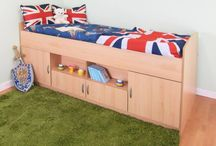 Rosey Midi Sleeper Bed / Rosey Cabin midi sleeper high bed. The Cabin Mid Sleeper Bed measures approximately 203cm long x 94cm wide x 89cm high. The Centre are has one large shelf . Two large cupboards, and two small cupboards. Available in Beech, Beech/Silver and White prices start at just £159.99 from http://www.mrsflatpack.co.uk/