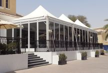 Pagoda Ultimate Tents / Boasts an eye catching design and a choice of glazed or hard wall panelling. White powder coating to supporting beams ensures a seamless, professional finish to these versatile units.  Ultimate is ideal for those looking for a compact temporary structure that's big on impact.